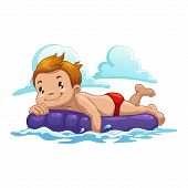 boy swim on the air mattress