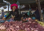Meat For Sale By Female Butcher On The Market.