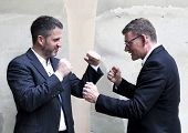 Two Men In Suits Boxing