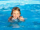 Little girl palying in a swimming pool