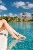 summer, beach, leisure and body part concept - closeup of woman legs at swimming pool