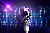Retro chrome microphone against digitally generated cool pixel background