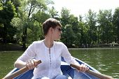 Woman Rowing Boat