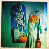 Instagram filtered image of vintage Halloween decorations hanging on a wall