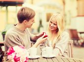 summer holidays, love, travel, tourism, relationship and dating concept - romantic man proposing to