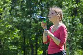 Young women blows bubbles