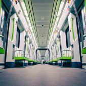 Inside a green empty subway car