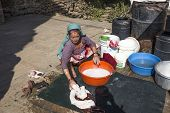 Elderly Woman Washes The Dirty Laundry In Kathmandu, Nepal