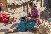 An Unidentified Girl Sews A Dress In The Backyard On December 2, 2013 In Changu Narayan
