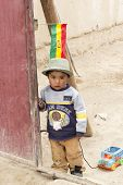 Uyuni, Bolivia - January 21, 2012: A Little Boy Plays With His Toy Car In A Desert Town. January 21,