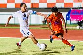 Sisaket Thailand-july 13: Alongkorn Pratoomwong Of Sisaket Fc. (orange) In Action During Thai Premie