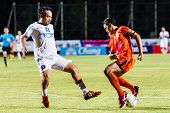 Sisaket Thailand-july 13: Sarayuth Chaikamdee Of Sisaket Fc. (orange) In Action During Thai Premier