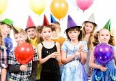 Group of happy kids having fun at a party. Isolated over white.