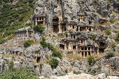 stock photo of rock carving  - Lycian rock cut tombs carved into the hillside of Myra Turkey - JPG