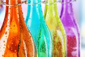 Colorful bottles on bright background