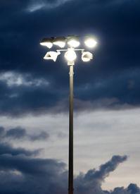 image of light fixture  - Stadium lights to a field during sundown - JPG