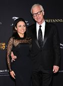 LOS ANGELES - OCT 30:  Julia Louis-Dreyfus & Brad Hall arrives to the BAFTA Jaguar Brittannia Awards 2014 on October 30, 2014 in Beverly Hills, CA