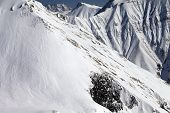 picture of avalanche  - Snowy rocks with avalanches - JPG