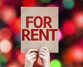 For Rent card with colorful background with defocused lights