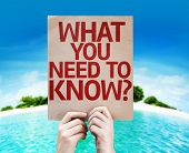 What You Need to Know? card with a beach background