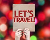 Let's Travel! card with colorful background with defocused lights