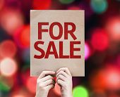 For Sale card with colorful background with defocused lights