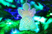 picture of christmas angel  - Knitted Christmas angel on Christmas lights background - JPG