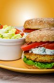 image of chickpea  - Vegetarian chickpea burger tomato and dip of herbs garlic and yogurt and salad with cherry tomatoes - JPG