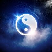 Yin Yang sign in dark night sky