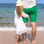 Happy father and adorable little daughter outdoors on the beach