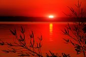 Red sunset on lake surface
