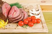 grilled barbecue on wooden plate with vegetables