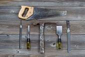 Hand Tools On Rustic Wooden Boards