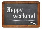 happy weekend  - white chalk text on a vintage slate blackboard