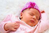 Newborn baby girl sleep on the fluffy blanket