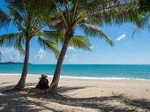 Thai woman sitting on the Tropical beach of Koh Samui island in Thailand