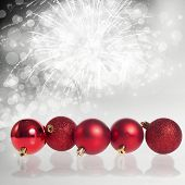 Red christmas balls on bokeh holiday background