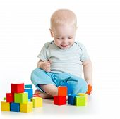 toddler kid boy playing  wooden toys