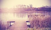 Vintage Retro Toned Image Of Lake In Autumn.