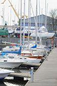 image of motor boat stand at a berth