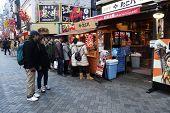 Unidentified Customers Queue To Buy Takoyaki In Osaka