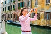 Happy Young Woman Taking Photo In Venice, Italy