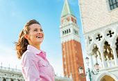 Happy Young Woman Against Campanile Di San Marco In Venice, Ital