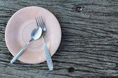 Spoon And Fork On A Pink Plate