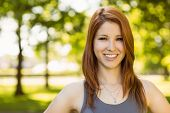 image of redhead  - Portrait of a pretty redhead smiling on a sunny day - JPG