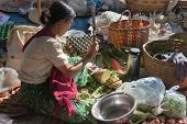 Burmese Woman Cut Vegetables On Asian Open Market