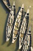 Old fishing boats at the river bank in Bandarban, Bangladesh.