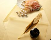 stock photo of inkwells  - Blank envelope with inkwell feather and pearl - JPG