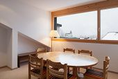 Architecture, comfortable chalet, wooden dining table