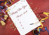 Happy New Year Resolutions Planning And Goal List On Dark Red Wood Background With Gold Stars And Fe